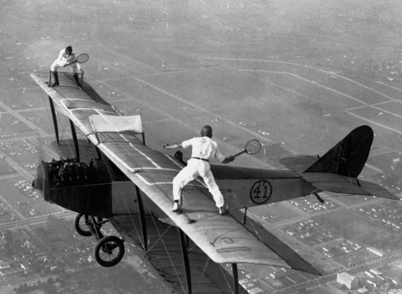 http://cdn.arkarthick.com/wp-content/uploads/2011/04/incredible-antique-OMG-photos-daredevils-tennis-biplane.jpg